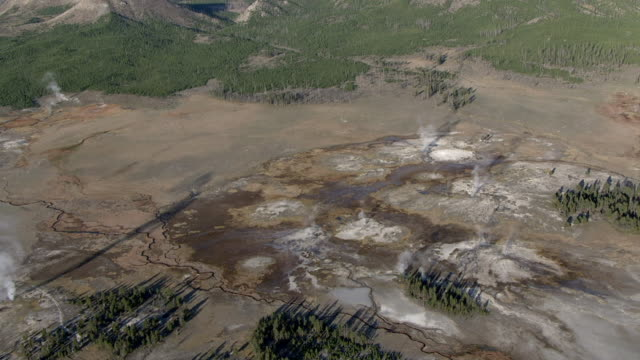 track over steaming hot springs, yellowstone, usa - bbc stock videos and b-roll footage
