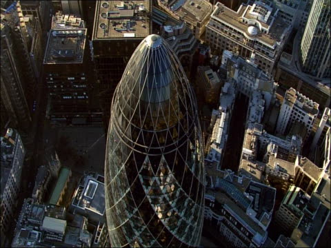track over 'the gherkin' in london's financial district - swiss re stock videos & royalty-free footage