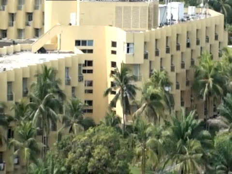 track over the hotel housing elected president alassane ouattara as incumbent leader laurent gbagbo refuses to relinquish power - côte d'ivoire stock videos & royalty-free footage