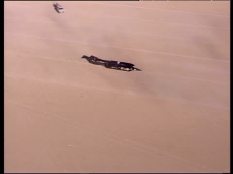track over thrust ssc at standstill in black rock desert with recovery vehicles after successfully breaking land speed record and sound barrier... - ネバダ州点の映像素材/bロール