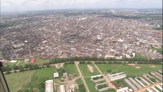 Track over urban sprawl of Port Harcourt, Nigeria, Aerial Shot
