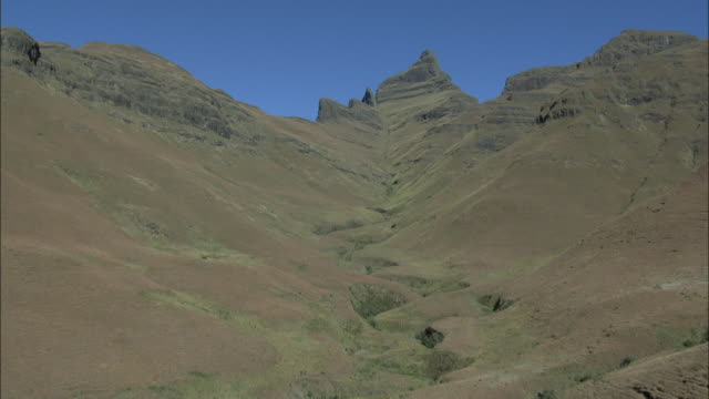 track over valley in the drakensberg mountain range. available in hd - drakensberg mountain range stock videos & royalty-free footage