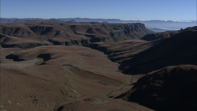 track over valleys in the drakensberg mountain range. available in hd - drakensberg mountain range stock videos & royalty-free footage