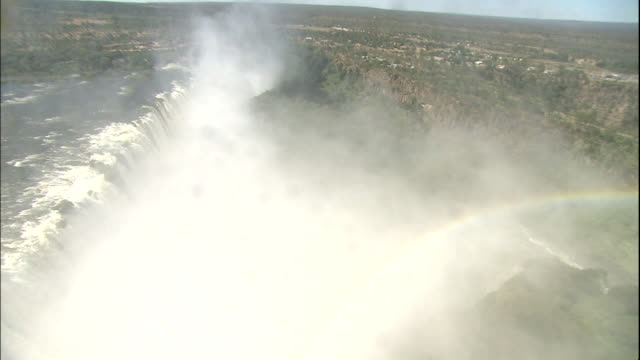 track over victoria falls, zimbabwe - victoria falls stock videos and b-roll footage