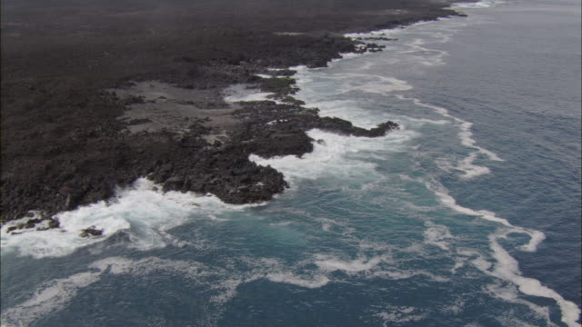 Track over waves crashing on coast of Fernandina, Galapagos Islands Available in HD.