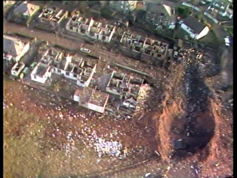 track over wreckage and dent in ground following lockerbie air crash - lockerbie stock videos & royalty-free footage