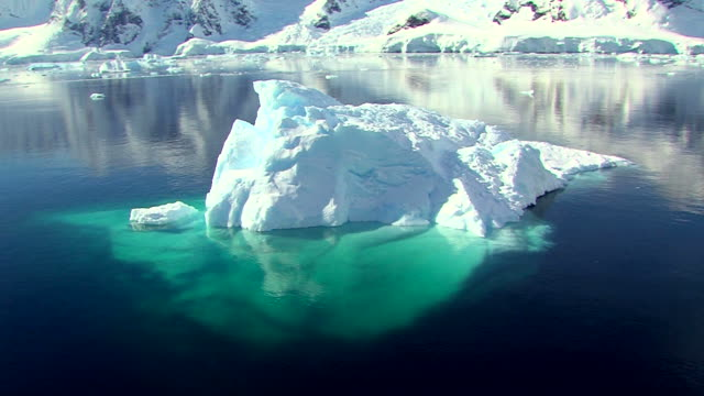 track past an iceberg in antarctica - antarctica iceberg stock videos & royalty-free footage
