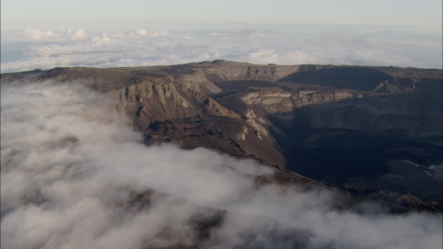Track past clouds on edge of crater of Sierra Negra Isabela Island Galapagos Available in HD.
