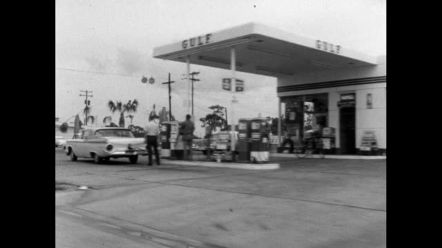 track past fuel station and fast food restaurant in usa; 1964 - advertisement stock videos & royalty-free footage