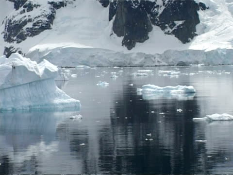 ms track past iceberg, mountains in the background, andvord bay, antarctic peninsula - antarctic peninsula stock videos & royalty-free footage