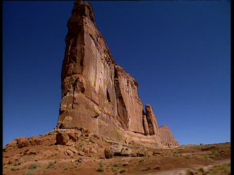 track past large sandstone rock formation arches national park utah - butte rocky outcrop stock videos & royalty-free footage