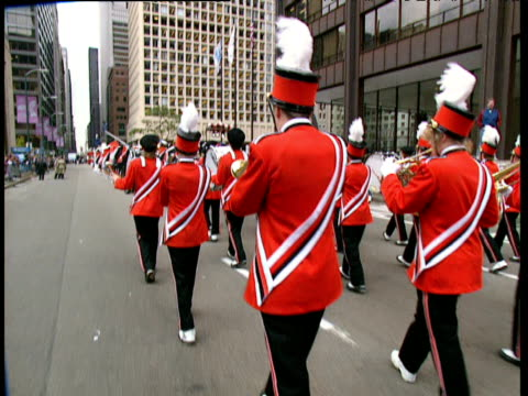track past marching band playing various instruments including trumpets and drums all wear matching red uniforms - marching band stock videos & royalty-free footage