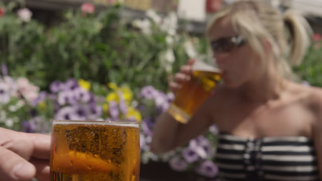 track past people drinking in pub garden, bristol, england - drink stock videos & royalty-free footage