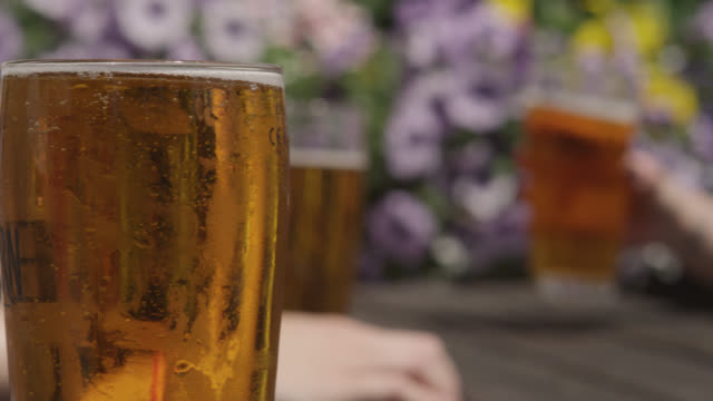 Track past people drinking in pub garden, Bristol, England