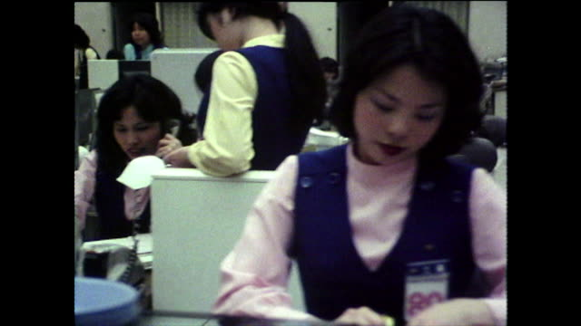 track past people working in japanese bank office; 1975 - only japanese stock videos & royalty-free footage