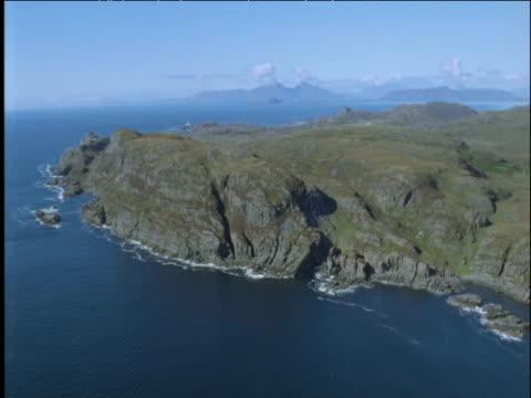 track past rugged coast and hills scottish highlands - ムラがある点の映像素材/bロール