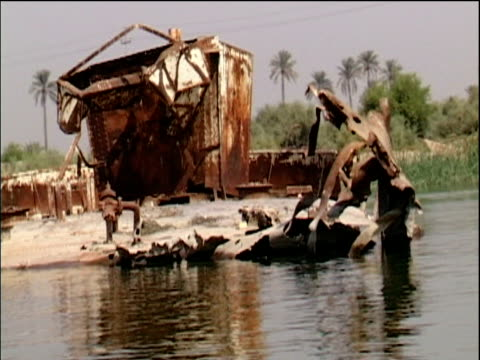 track past rusting wreckage of gulf war ships basra - basra stock-videos und b-roll-filmmaterial