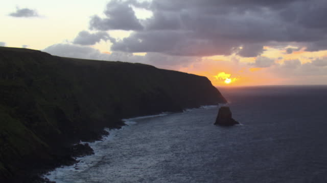 Track past tall cliffs and sea at sunset, Easter Island