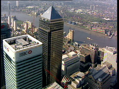 track right across business district of london's canary wharf including skyscrapers with the river thames in the background - river thames stock videos & royalty-free footage