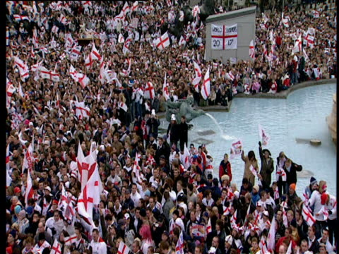track right across trafalgar square surrounded by hundreds of fans waving st george's flags england rugby union world cup victory parade; 08 dec 03 - rugby stock videos & royalty-free footage