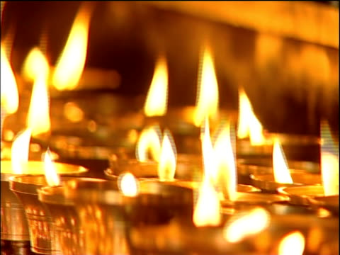 Track right along line of temple candles in gold candle-holders