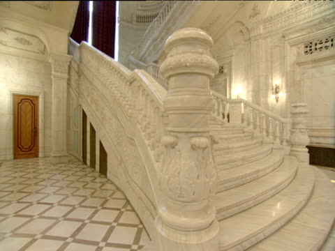 Track right along marble grand staircase in Ceaucescu's Palace world's second biggest building Bucharest