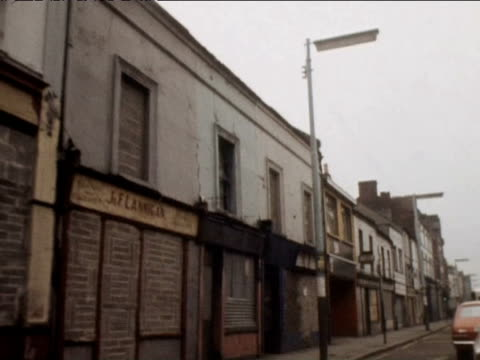 Track right along streets with boarded up windows 1974