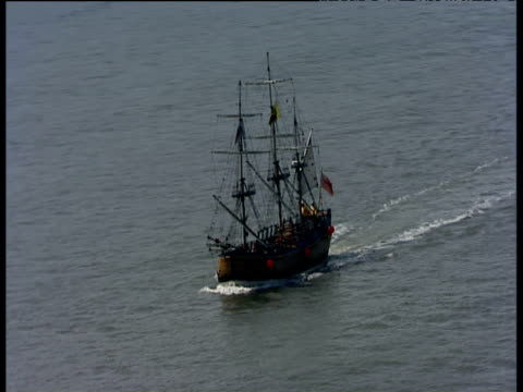 Track right around and zoom out from replica of HMS Endeavour off coast of Whitby England