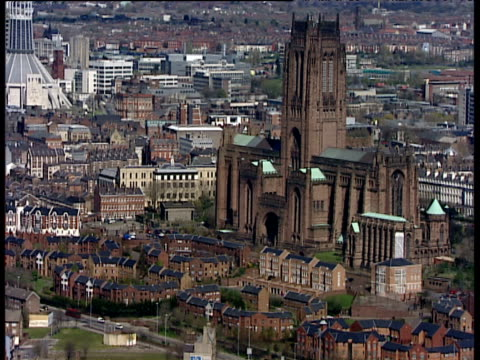 Track right around Liverpool Anglican Cathedral Catholic Cathedral in background