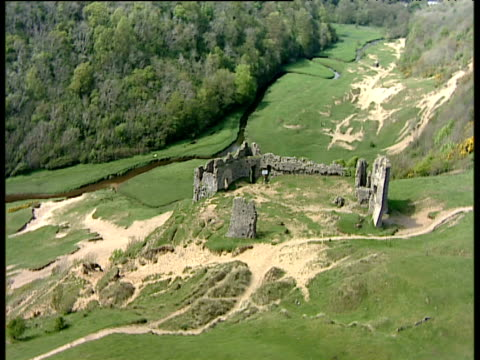 Track right around ruins of Pennard Castle on hillside Gower Peninsula South Wales