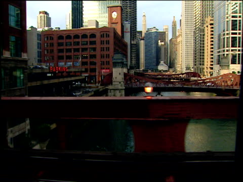 track right from train over bridge across river through business district chicago - elevated train stock videos and b-roll footage