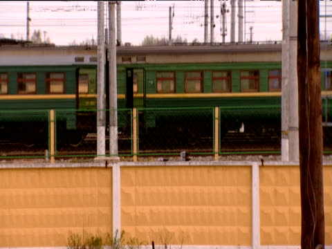 track right from train window past other trains russia - 操車場点の映像素材/bロール