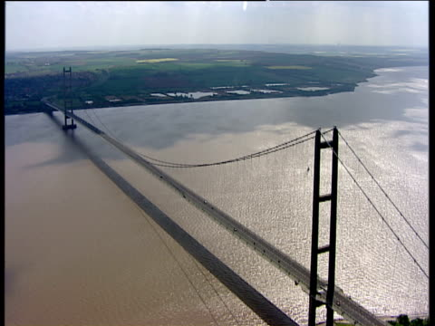 track right over humber bridge east yorkshire - suspension bridge stock videos & royalty-free footage