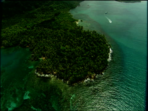 track right over peninsula covered in lush green tropical rainforest panama - peninsula stock videos and b-roll footage