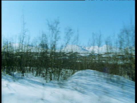 stockvideo's en b-roll-footage met track right over snowy landscape, abisko, sweden - jaar 2000 stijl