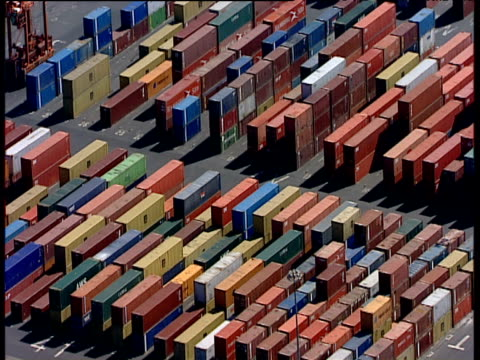 Track right over stacked containers in huge yard at Seaforth Dock Liverpool