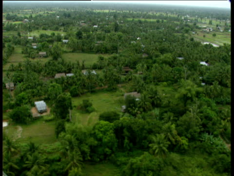 track right over varied landscape farms and flooded fields and wooded areas cambodia - cambodia stock videos and b-roll footage