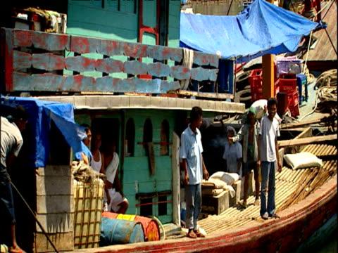 stockvideo's en b-roll-footage met track right past boat moored in padang harbour sumatra indonesia - ruimte exploratie