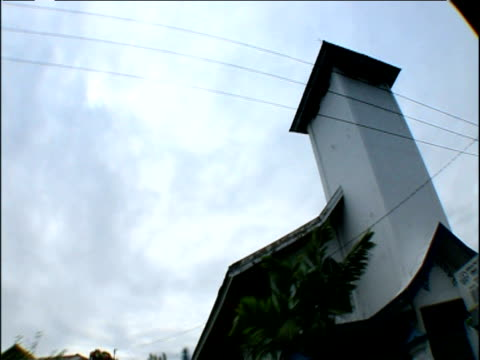 vídeos y material grabado en eventos de stock de track right past christian church in fractious religious area sulawesi indonesia - chapitel