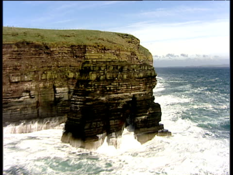 track right past stacks of duncansby and rock strata in cliff face caithness - rock face stock videos & royalty-free footage