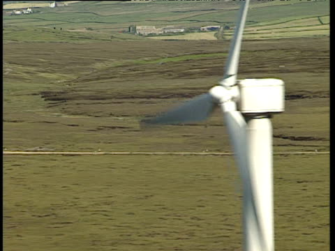 Track right past wind farm on hilltop Yorkshire