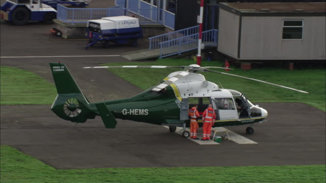 track round air ambulance in airfield available in hd. - helicopter landing pads stock videos and b-roll footage