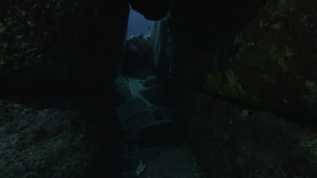 Track through narrow crevice in Yonaguni monument. Japan