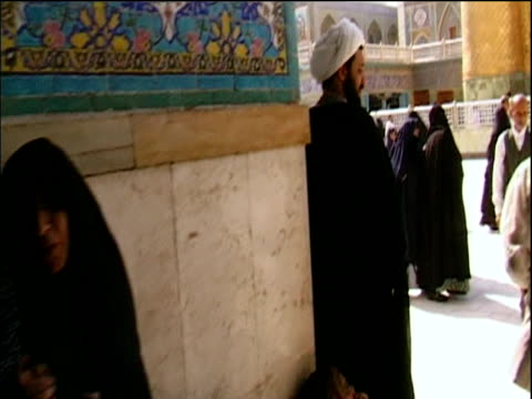 track through shrine of imam ali with people passing by karbala iraq - najaf stock-videos und b-roll-filmmaterial