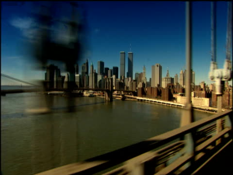 track towards manhattan across manhattan bridge new york city - world trade center manhattan stock videos & royalty-free footage