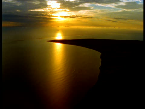 track towards setting sun over sea, ningaloo reef, western australia - ningaloo reef stock videos & royalty-free footage