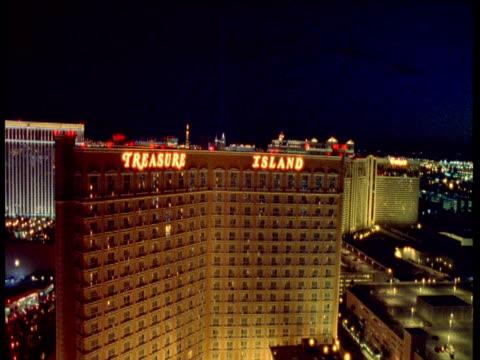 track up and over treasure island casino at night, las vegas - casino stock videos & royalty-free footage