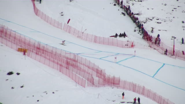 ms pov  tracker at lauberhorn ski race / wegen, bernese oberland, switzerland - bastoncino da sci video stock e b–roll