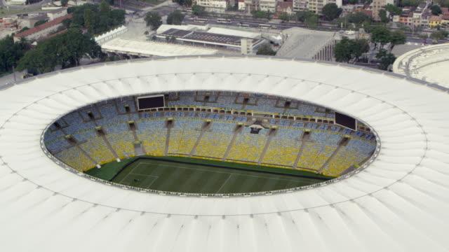 tracking aerial footage of maracanì£ stadium - sport venue stock videos & royalty-free footage