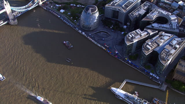 Tracking aerial shot over River Thames and The City